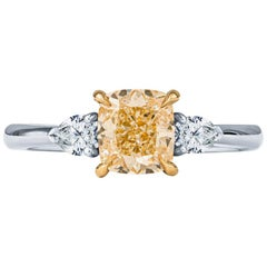 1.51ct Cushion Cut Light Yellow Diamond with 0.25 Carat Pear Shape Diamond Ring