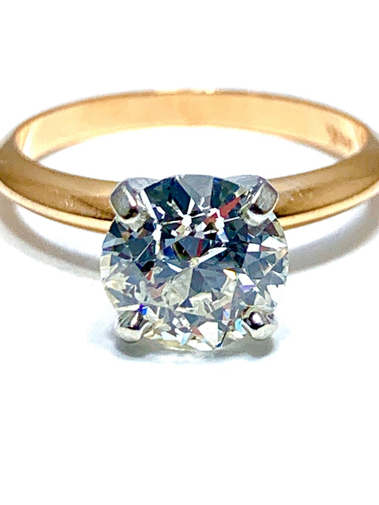 A gorgeous 1.52 carat old European cut diamond solitaire engagement ring.  The diamond is graded as I color, SI1 clarity, and  is set with a four prong platinum head, and a 14 karat rose gold knife edge shank.  The ring is currently a size 5.50, and