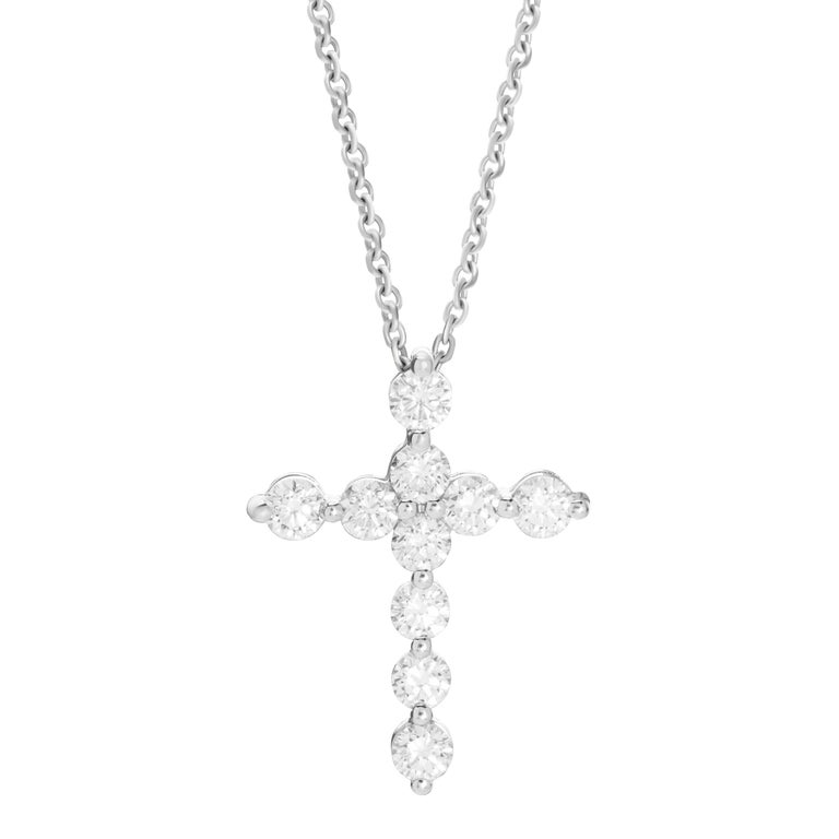 18-karat white gold necklace features a cross pendant accented by 1.52 carats of round brilliant cut diamonds.  Chain length 16 inches.  Pendant height 2.5cm, pendant width 2cm.   Composition: 18K White Gold 10 Round Diamonds: 1.52 carats Diamond