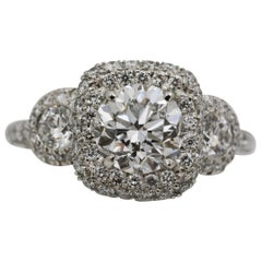 1.52 Diamond Halo Three-Stone Platinum Ring