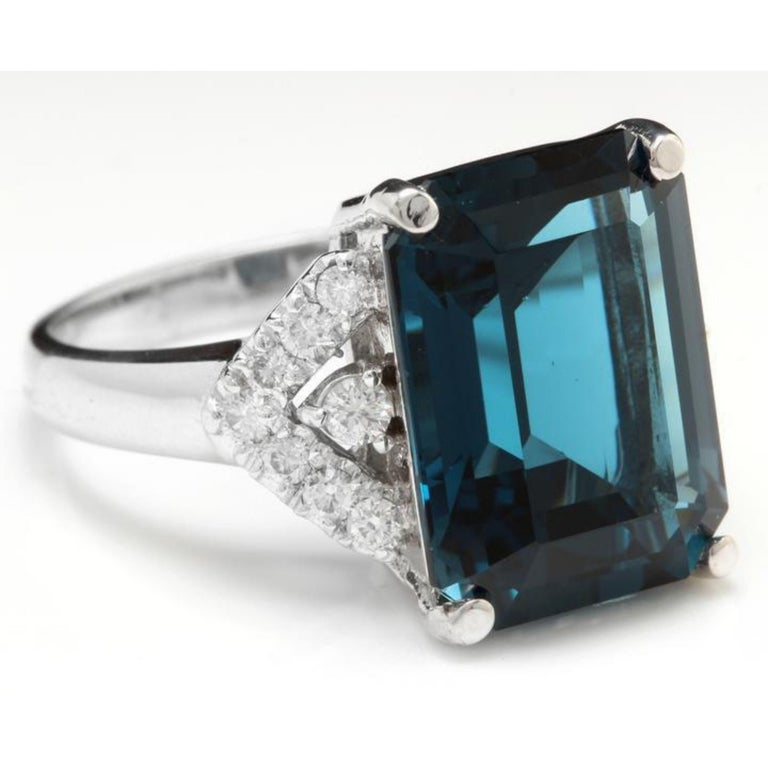 15.20 Carats Natural Impressive LONDON BLUE TOPAZ and Diamond 14K White Gold Ring  Total Natural London Blue Topaz Weight: Approx. 14.50 Carats  London Blue Topaz Measures: Approx. 16 x 12mm  Natural Round Diamonds Weight: Approx. 0.70 Carats (color