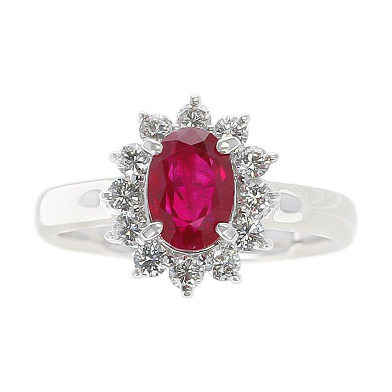 An Oval Ruby Engagement Ring with Diamond Halo made in Platinum. Ruby Weight: 1.54 carats, Diamond Weight: 0.45 carats. Ring Size US 6. Total Weight: 6.84 grams.
