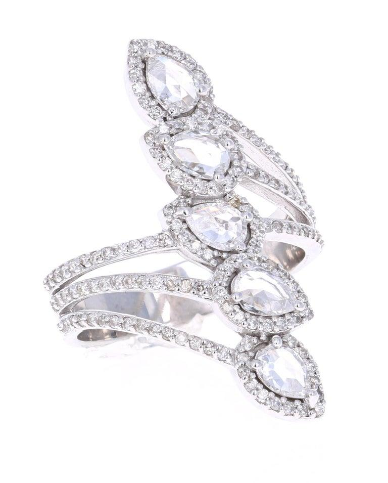 A gorgeous cocktail ring that will elevate your accessory collection of vintage and antique style jewelry!   It has 5 Pear Cut Rose Cut Diamonds that weigh 0.92 Carats. The Rose Cut Diamonds bring out the antique-ness and vintage style of this