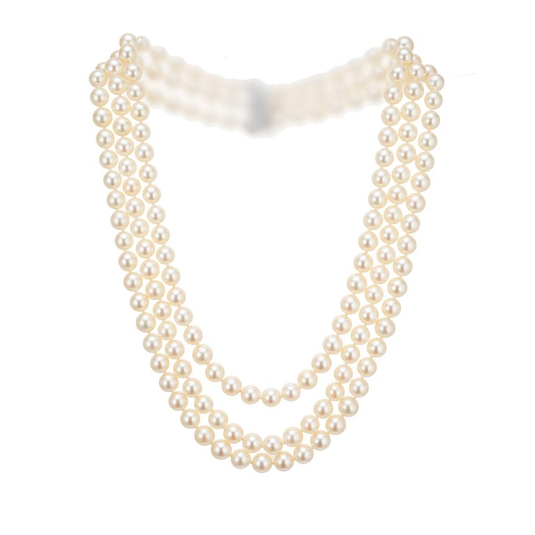 Mid-Century 1950's triple strand cultured pearl necklace. 14k white gold catch with baguette, marquise and round accent diamonds. 17, 18, 19 inches in length.   170 cultured crème hue pearls, excellent lustre, few blemishes, well matched 5 marquise