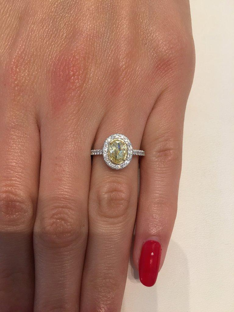 e094b6ff8ee11 1.55 Carat Fancy Yellow Oval Cut Diamond Engagement Ring