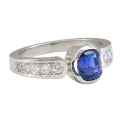 1.56 Carat Blue Sapphire with .34 Carat Diamonds in Platinum