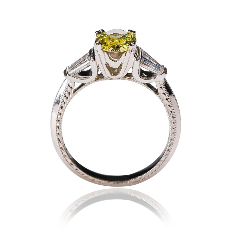 Modern 1.58 Carat Oval Yellow Diamond Baguette Platinum Ring by Tacori For Sale