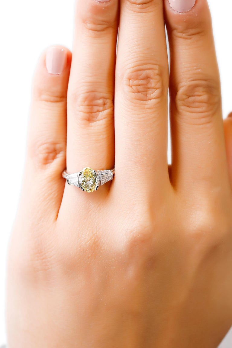 1.58 Carat Oval Yellow Diamond Baguette Platinum Ring by Tacori In New Condition For Sale In New York, NY