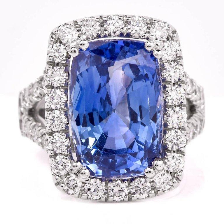 This spectacular sapphire and diamond cocktail ring is crafted in solid 18-karat white gold, weighing 12.3 grams and measuring 21mm x 20.50mm. Showcasing one GIA lab reported natural cushion-shape blue sapphire, with no heat or treatments, weighing