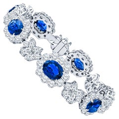 15.88 Carat Oval Sapphires and 16.42 Carat Diamond Flower and Butterfly Bracelet