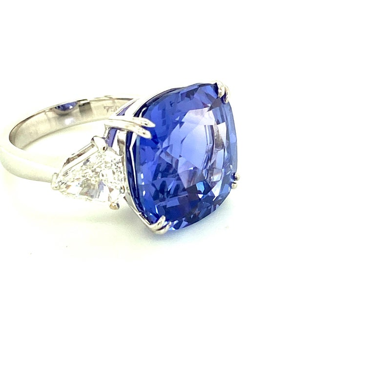 15.97 Carat GRS Certified No Heat Color Change Sapphire And Diamond Ring:  A magnificent ring, it features a huge 15.97 carat GRS certified unheated (no heat) color-change sapphire accented by two kite-cut white diamonds to form a beautiful