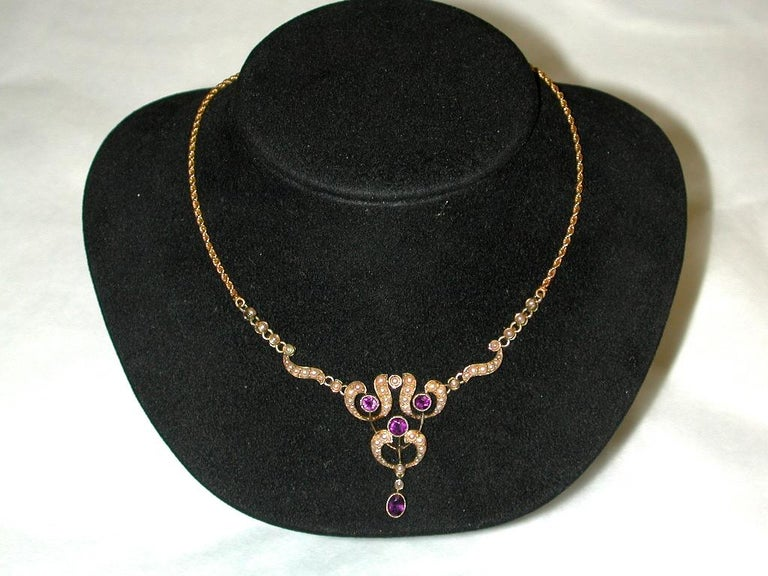 15ct Gold Pendant Set with Half Pearls,and Amethysts,Integral Rope Chain, c.1910 Beautifully made, completely flexable with solid rope chain and barrel snap. This exquisite piece has hardly been worn and is in pristeen condition. The half seed