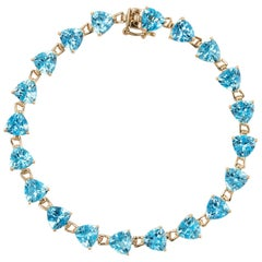 16 Carat Blue Topaz Bracelet Tennis Line Estate 14K Gold Trillion Cut Jewelry