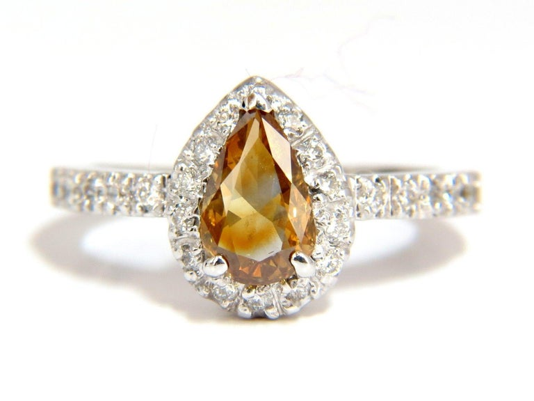 Sparkling Golden Yellow Browns Flash Fancy color Pear cut Diamond ring.  Natural Fancy color Center diamond: 1.10ct.   Pear shape  5.2 X 7.9 mm  Si-1 clarity    .60ct. Side rounds diamonds:  G-color Vs-2 clarity.  14kt. white gold  4.4