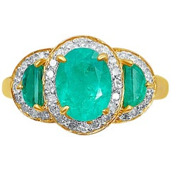 1.60 Carat Oval Cut Colombian Emerald, Diamond, and 18K Yellow Gold Ring