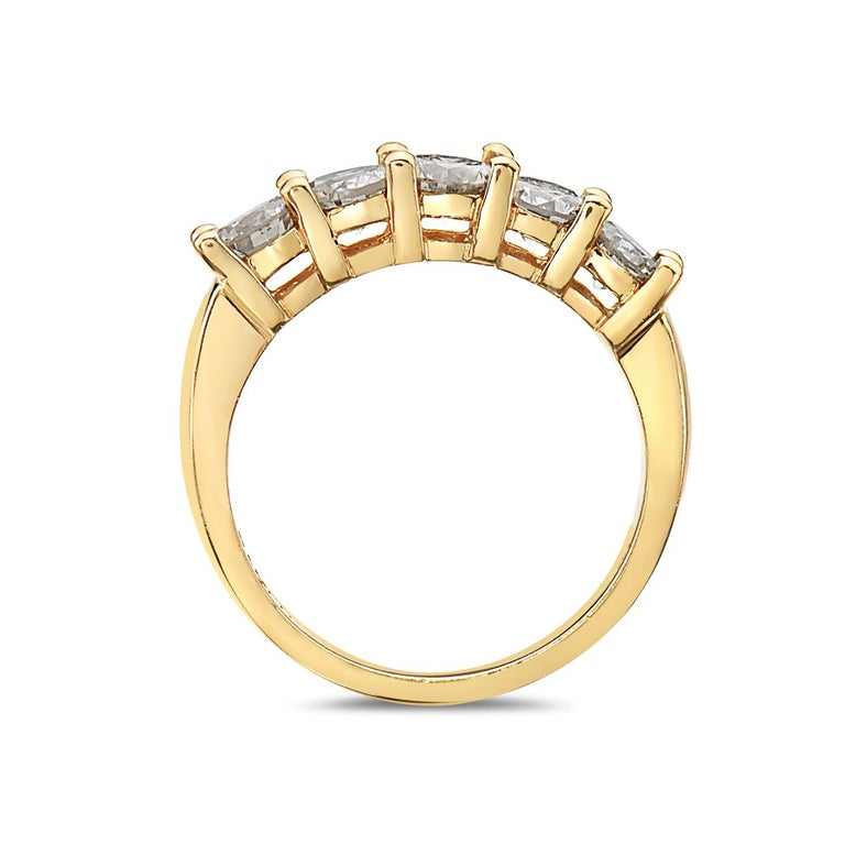 This engagement ring features 5 round brilliant diamonds weighing total 1.60 ct. set in 14K yellow gold. 4.8 grams total weight. Size 7 1/4.  Resizeable upon request.  Viewings available in our NYC showroom by appointment.