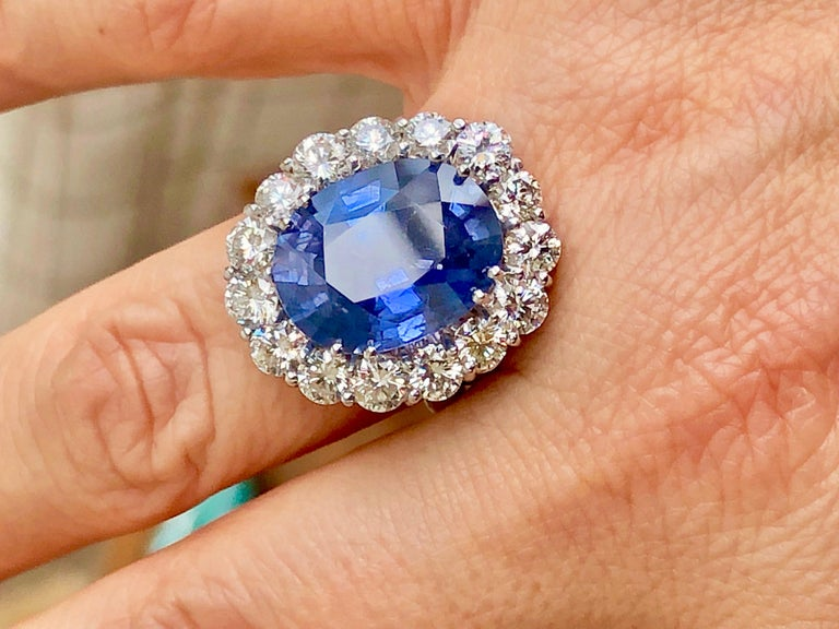 Magnificent, very large no heat, untreated oval cut blue sapphire 12.73 carat GIA Certified. 18K White Gold engagement ring. The ring was designed and made to bring out and showcase the natural beauty of the center stone. Fifteen white brilliant
