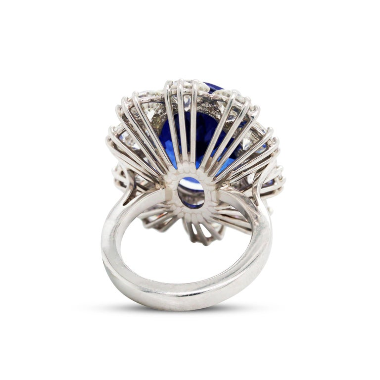 16.07 Carat Oval Tanzanite Platinum Large Diamonds Cocktail Ring  This state of the art ring features a Tanzanite center, oval, with incredible color and quality. It is 16.07 carats total weight.  Dimensions: 15mm x 11mm  10 Diamonds surround the