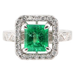 1.61 Carat Natural Emerald and Diamond Engagement Ring Set in Platinum