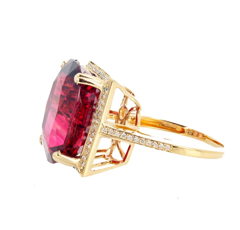 Glittering brilliant natural red 16.21 carat Tourmaline - 17 m x 16 mm - set in this beautiful white diamond enhanced 14KT yellow gold ring size 7 sizable.  There are natural slightly visible inclusions in this gorgeous gemstone that cause