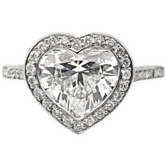 1.63 Carat GIA Certified F Si1 Heart Shaped Diamond with a Halo, 18 Karat Gold