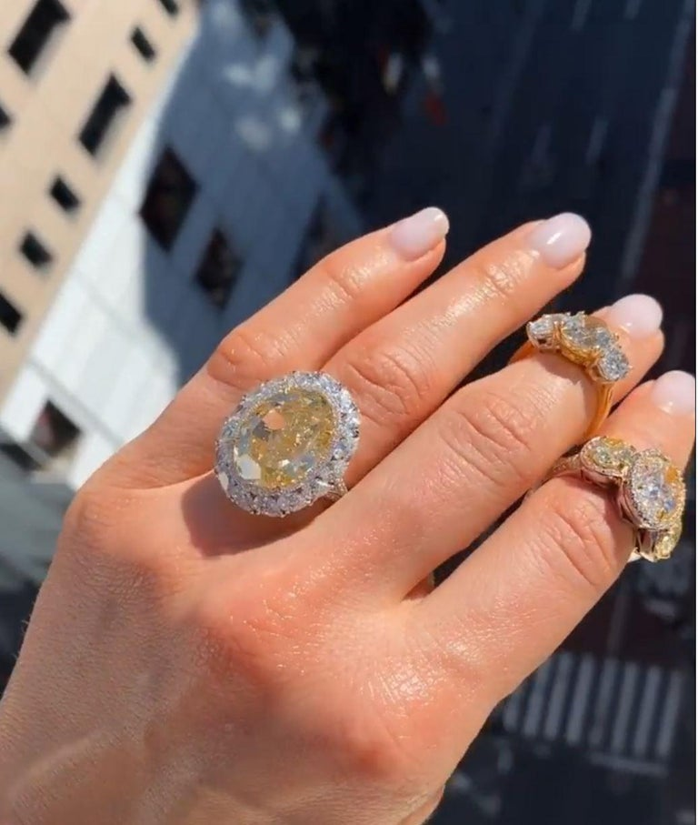 Very Rare 16.30 Carat Fancy Intense Yellow VS2 Oval Diamonds, set with 5 Carats of diamonds Certified by GIA Looks like 25 Carats. Set in a custom made diamond mounting  Investment quality.