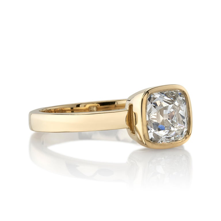 1.64ctw I/VS1 GIA certified Cushion cut diamond set in a handcrafted 18K yellow gold mounting.  Ring is currently a size 6 and can be sized to fit.