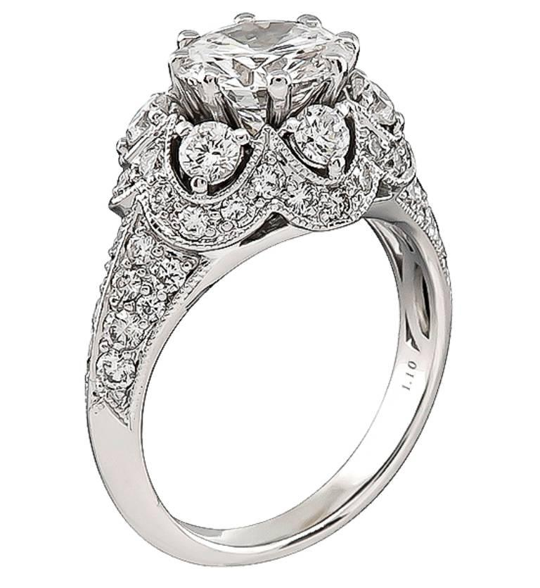 This unique stunning 18k white gold engagement ring is centered with a sparkling GIA certified round brilliant cut diamond that weighs 1.64ct. graded D color with VVS2 clarity. Accentuating the center stone are high quality round cut diamonds that