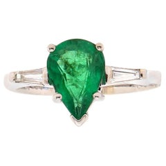 1.64 Carat Oval Emerald and Diamond Engagement Ring