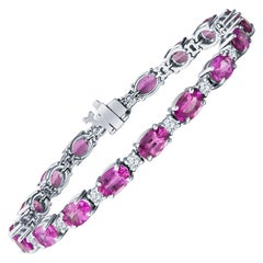 16.48ctw Oval Pink Sapphire and 1.72ctw Round Diamond White Gold Tennis Bracelet