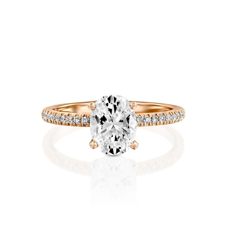 Exquisitely hand crafted ring features a solitaire GIA certified diamond. Ring features a 1.5 carat oval cut 100% eye clean natural diamond of F-G color and VS2-SI1 clarity and it is accented by diamonds of approx. 0.15 total carat weight. Set in a