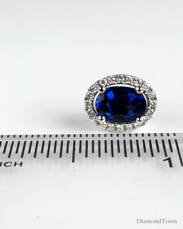 1.65 Carat Oval Cut Blue Sapphire Earrings with Diamond Halo in 18k White Gold For Sale 2