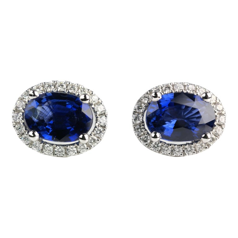 1.65 Carat Oval Cut Blue Sapphire Earrings with Diamond Halo in 18k White Gold For Sale
