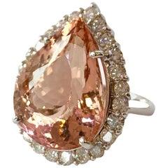 16.5 Carat Pear Shaped Morganite and Diamond Halo 14 Karat White Gold Ring