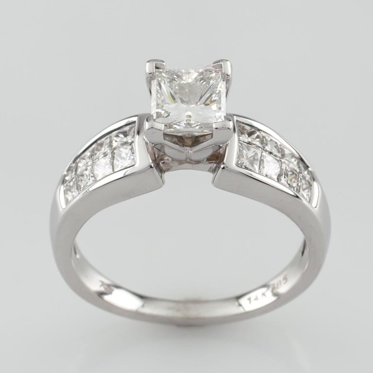 Gorgeous Princess cut engagement ring with Princess cut accent stones Ring Size 7 Total Mass = 5.3 grams Center Stone Details: Cut: Princess Size: 1.0 Carats Color: H Clarity: SI2 Accent stones are princess cut (2 rows of 4 diamonds on each side of