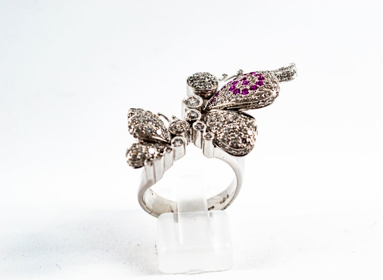 This Ring is made of 18K White Gold. This Ring has 1.65 Carats of White Modern Round Cut Diamonds. This Ring has 0.15 Carats of Rubies. Size ITA: 16 Size USA: 7.5 We're a workshop so every piece is handmade, customizable and resizable.