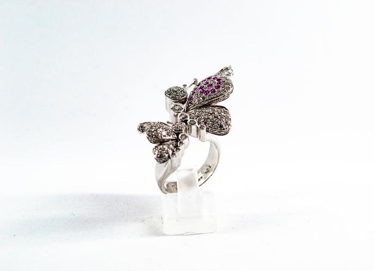 Art Nouveau 1.65 Carat White Diamond 0.15 Carat Ruby White Gold Butterflies Cocktail Ring For Sale