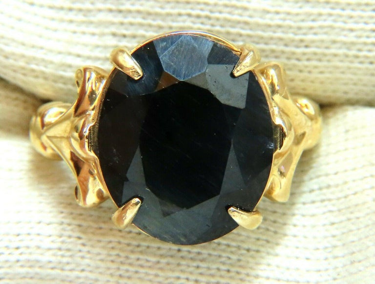 16.50ct. Natural Oval cut Black sapphire ring.  Center Sapphire:  15 X 13mm  14kt Yellow gold.  7.4 grams.  current ring size:   8.25  can be resized   please inquire