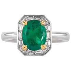 1.66 Carat Emerald with Baguette Diamond Halo Ring 18 Karat White Gold