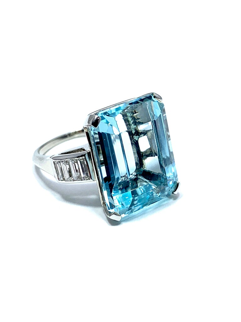 An absolutely beautiful 16.60 carat emerald cut Aquamarine and Diamond ring!  The Aquamarine is a cool sky blue color, set with four prongs, and four emerald cut Diamonds on each side of the shank.   The Diamonds have a total weight of 0.80 carats.