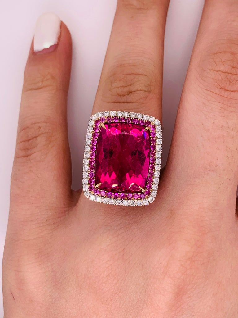 Stunning Pink Tourmaline and Diamond Ring in white gold The center stone is 16.60 Carats Pink Tourmaline, surrounded by 0.80 carats of small pink tourmalines  and 1.50 carats of white brilliant cut diamonds.