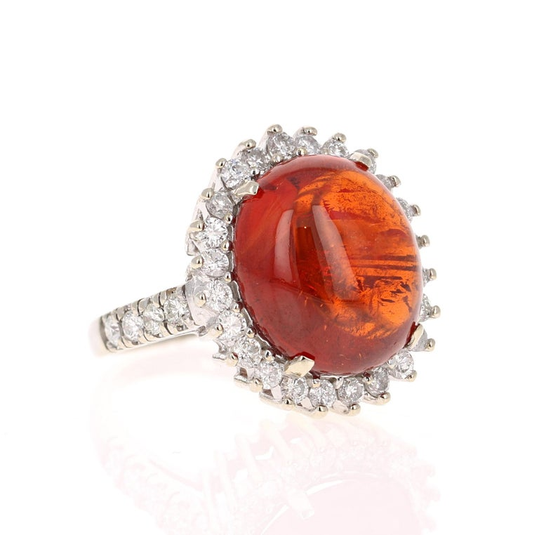 16.69 Carat Cabochon Spessartine Diamond White Gold Cocktail Ring! This beautiful ring has a huge 15.51 Carat Cabochon Spessartine set in the center of the ring. A Spessartine is a natural stone that is actually a part of the Garnet family of