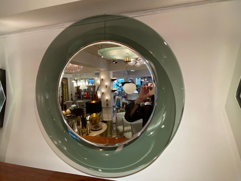 A '1669' model circular concave glass mirror designed by Max Ingrand for the Milanese company, Fontana Arte, circa 1960. This beautiful green bevelled glass example with an inner chromed brass surround, was made using only the finest quality