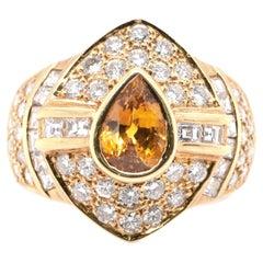 1.67 Carat Natural Yellow Sapphire and Diamond Ring set in 18 Karat Gold