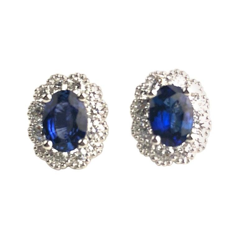 DiamondTown 1.67 Carat Oval Cut Blue Sapphire Earrings in Diamond Halo 18K Gold For Sale
