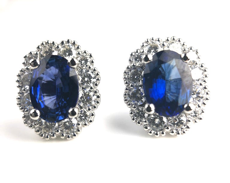 1.67 Carat Oval Cut Blue Sapphire Earrings with Diamond Halo in 18k White Gold In New Condition For Sale In New York, NY