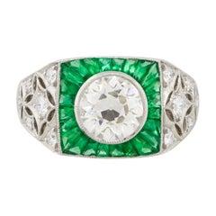 1.67 Carat Round Diamond Center Wide Ring with Emeralds Platinum in Stock