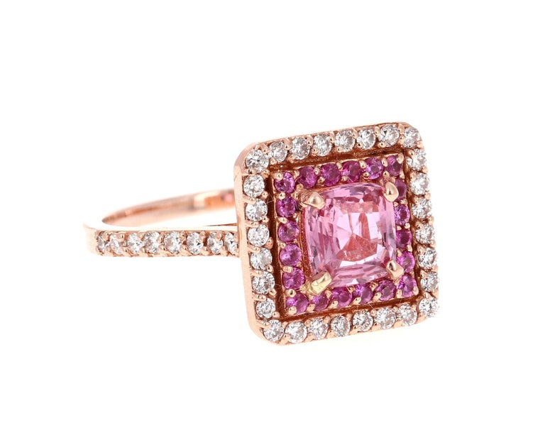 Simply the most elegant and beautiful Pink Sapphire and Diamond Engagement or Wedding Ring!  The center Cushion Cut Pink Sapphire is 1.02 Carats and is surrounded by a halo of 20 Pink Sapphires that weigh 0.23 Carats, followed by another halo of 44