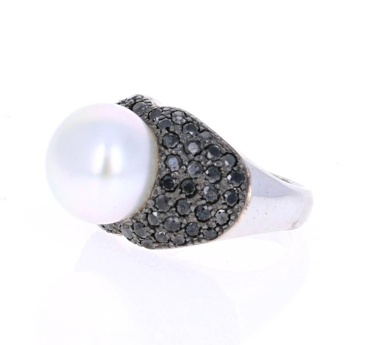 A Gorgeous 1.68 carat South Sea and Black Diamond Cocktail ring that is sure to elevate your look!  There is a beautiful South Sea Pearl in the center of the ring which is surrounded by 60 Black Round Cut Diamonds that give this ring a very elegant
