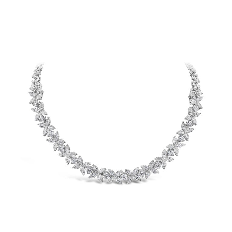 A beautiful floral motif necklace than can be disassembled to two flower bracelets. Showcases a cluster of marquise and round brilliant diamonds, set half-way throughout the necklace. One side is made in 18k white gold. Diamonds weigh 16.92 carats